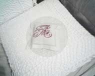 © as 2009 - White crochet cushion with monogram